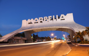 Marbella Arch illuminated at night. Andalusia, Spain